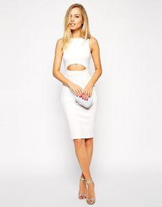 10 Holiday Dresses Under $100 | theglitterguide.com