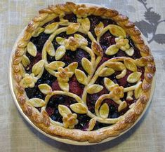I don't have the recipe for this pie. It looks to be a mixed berry pie. I love the fancy top crust design. I have to try this instead of the lattice next time.