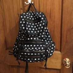 Star backpack Black and white star back pack good used condition! Medium sized Bags Backpacks