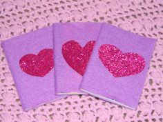Doc McStuffin's party    Tiny composition books (found at Walmart. I found a 3 pack for under 2 bucks.) covered with purple felt, attached with hot glue. Sparkly heart was made from a sheet of sparkly pink paper found at Hobby Lobby.
