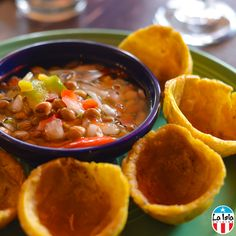 Gandules dip - a blend of onions, garlic, red peppers, green pigeon peas, olive oil, vinegar and spices, served cold with tostone cups. | La Isla Cuisine