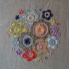 inspiring, floral, soft coloured embroidery on grey linen, sigh.