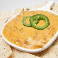 This recipe makes an addictive, cheesy nacho dip with hamburger and just the right amount of spice. Chicken Nacho Dip Recipe, Chicken Nachos, Dip Recipes, Sauce Recipes, Appetizer Recipes, Mexican Recipes, Hamburger Dip, Mexican White Cheese Dip, Dip For Tortilla Chips