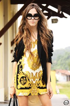 This is an ad for sunglasses but I love the short dress with blazer look