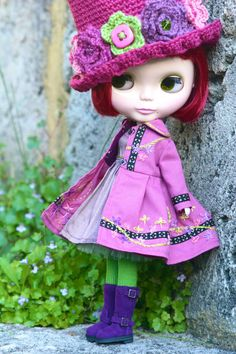 Blythe is wearing this gorgeous hand-embroidered trench coat in a very pretty shade of orchid pink. Your girl will love gardening in the Spring in this