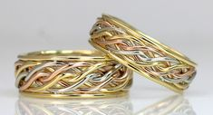 tritone six strand open weave outer band ring