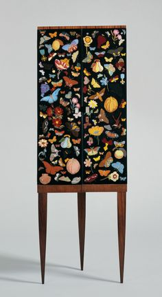 """Corner cabinet with reverse-painted glass doors"" Designed by Gio Ponti, and the doors were painted by Fornasetti. The ""farfalle"" (butterflies) decoration is a motif that Fornasetti regularly employed. Funky Furniture, Furniture Makeover, Painted Furniture, Home Furniture, Furniture Design, Furniture Stencil, Plywood Furniture, Corner Furniture, Furniture Showroom"