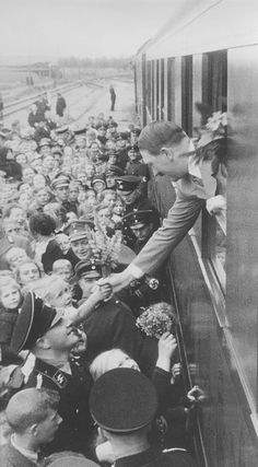 Der Führer in Wilhelmshaven-1936. (via juliamuller1889).  By 1936, people were seeing vast improvements in their work- life balance, and it was all due to Adolf. No wonder they treated him like the Messiah.