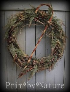Primitive Candy Cane Christmas Wreath with Red Berries and Rusty Bells #NaivePrimitive #PrimbyNature