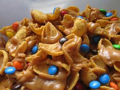 Salty Sweet Peanut Butter Caramel Funky Fritos.  Pinner says they are great with candy corn instead of the M&M's.  Great treat to take to the pumpkin patch or to eat while watching football.