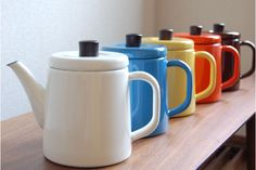 Nodo Horo Pottle enamelware teapot, in multiple colours, straight slightly tapering sides and flat lid, porcelain enamel over metal, C. 2010s, Japan