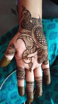 Check out the 60 simple and easy mehndi designs which will work for all occasions. These latest mehandi designs include the simple mehandi design as well as jewellery mehndi design. Getting an easy mehendi design works nicely for beginners. Peacock Mehndi Designs, Latest Arabic Mehndi Designs, Back Hand Mehndi Designs, Full Hand Mehndi Designs, Mehndi Designs Book, Mehndi Designs For Girls, Mehndi Designs For Beginners, Mehndi Design Photos, Mehndi Designs For Fingers
