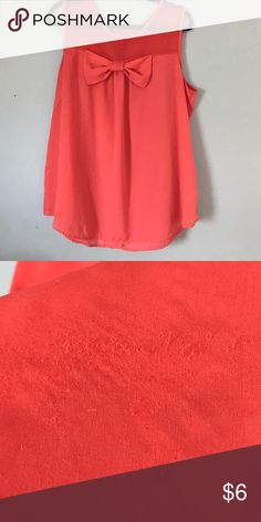 Coral/Orange tank top with bow Preloved. There is a some wear on the back that can be covered with a sweater or blazer. The front is in excellent condition Tops Tank Tops