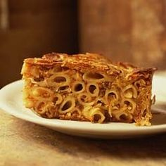 Timpana is the ultimate pasta pie. Macaroni is cooked separately (to under al dente stage) and added to a rich bolognaise style sauce, often...