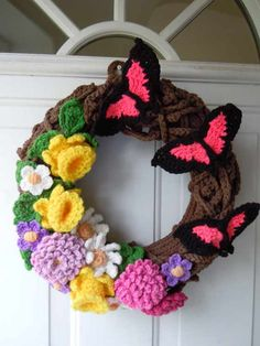 Crochet Wreath -- not sure I would crochet it out but I love this as a template for a pretty spring wreath!