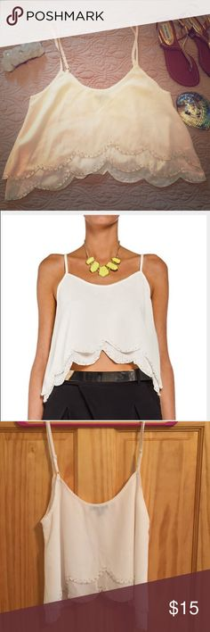 NWOT White scalloped crop top sz M Never worn! White scalloped edge crop top. The scalloped edge has a beaded trim. Cute with high waisted jeans or cut-off jeans. I also have this top available in green. I bought both for vacation, but have never worn them. TCEC Tops Crop Tops