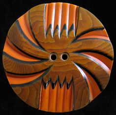 Carved Celluloid Wafer Button - just sold for $171 on eBay