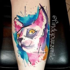 Stylish cat watercolor tattoo on forearm for woman