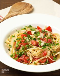 """Pasta with Fresh Tomatoes and Herbs -  UNDER 30 MINUTES - The easy-to-make, uncooked """"sauce"""" for this simple pasta dish consists of juicy, ripe tomatoes, fragrant basil, parsley, fresh mozzarella, extra virgin olive oil and a splash of balsamic vinegar."""