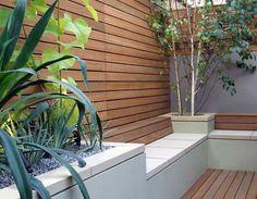 Horizonal decking on a courtyard wall