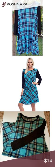 New Large black and blue plaid dress This is a pretty black and blue plaid dress by Betsy Red Couture size large. It's perfect for fall. 92% polyester, 8% spandex. Cute and comfy. New without tags. I bought it for boutique, so no tags attached. Dresses