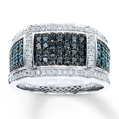 This incredible men's ring showcases rows of round Artistry Black Diamonds™ at its center. Rows of round Artistry Blue Diamonds™ decorate either side, while round white diamonds frame the ring in brilliance. The ring, crafted in 10K white gold, has a total diamond weight of 1 carat. Artistry Blue Diamonds™ and Artistry Black Diamonds™ are treated to permanently create the intense blue and black colors.