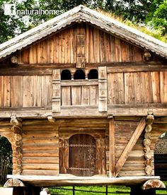 This is a 'Loft' from Sondre Tveito in Telemark, Norway which now stands in the Norwegian Folk Museum in Oslo. The tiny door leads to the 'Bu', the ground floor room used for storing food. The upper floor was for unmarried women in the working seasons. The loft has a runic inscription dating the house to 1300. You can see a panoramic view of house at the Norwegian Folk Museum. More about this and other homes here www.naturalhomes.org/naturalbuilding900years.htm