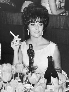 1961 - Elizabeth Taylor (Getty Images) - 11 Iconic Oscars Photos You've Definitely Never Seen Before via @WhoWhatWear