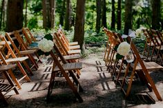 by Paul Carlson -- Ceremony chairs in the forest