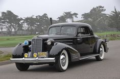 1937 Cadillac Series 90 V-16 Fleetwood 2-Passenger Coupe. Two passengers vs. 16 cylinders. WTF.