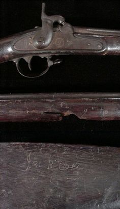 """KIA Carolinian's Struck Palmetto Number Description and Photograph Price The bullet struck Palmetto Armory rifle-musket shown here was carried by Private James Bowen Collins, Company L, 21st South Carolina Infantry. """"Jas B Collins"""" is carved into the right stock face, leaving no doubt as to its owner. Private Collins enlisted in April 1862. After two years of garrison duty in Charleston, South Carolina, the 21st was sent to the Army of Northern Virginia under General Hagood. In his private…"""