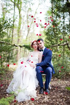 Inspirational photoshoot for a wild, colourful woodland wedding from photographer Ilaria Petrucci for british-bride.co.uk. Flowers, moss, champagne, flower covered umbrella, blue grooms suit, confetti, tree trunk cake stand Woodland Wedding Inspiration, Reception Party, Confetti, Garden Sculpture, Wedding Gowns, Photoshoot, Bride, Grooms, Wedding Stuff
