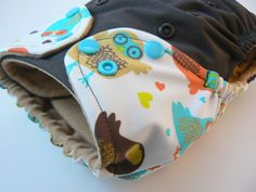 One Size Cloth Diaper - Retro Owls Embellished Waist on Brown PUL with Welt Opening on Tan Microchamois. $15.00, via Etsy.