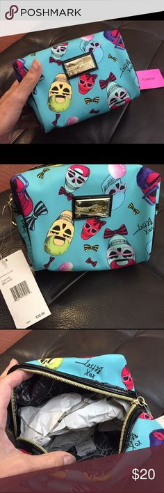 Betsey Johnson bag NWT brand new unused Betsey Johnson bag with vibrant colorful skulls on a turquoise blue background.    The fun skulls are donning glasses, hats, bows and chewing gum.     Zips closed.  Great makeup or toiletries bag, great gift.    Plastic film is even still on the gold-tone metallic logo plate. Betsey Johnson Bags Cosmetic Bags & Cases