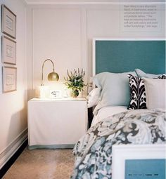 fabric covered bedside table via Lonny