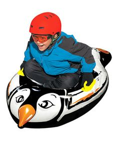 Get that extreme winter sports feeling while flying down snowy hills this season. This extra heavy-duty 16 gauge vinyl sled is constructed for optimum fun and has a unique penguin shape and cool graphics.