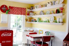 Fifties kitchen.  Like the colors minus the commercial Coca Cola stuff.