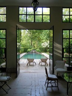Howard Design Studio -- how cool would it be to look through front door at a pool like that?