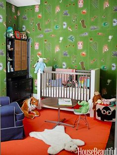 Nursery walls are upholstered in Marimekko's playful African Kuningatar. Design: Steven Sclaroff
