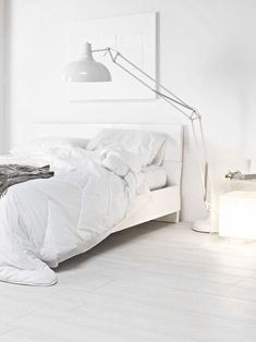 = white linen and oversized lamp