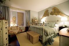 Traditional Bedroom Decorated With Angel Wings Wall Decor And Using Metal Bed : Bedroom Wall Decor Creates An Ambiance Inside The Room