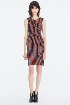 This fresh sleeveless faux wrap dress was made for layering. In a vibrant rickrack print, it can stand alone in summer or be worn under or over a slim…