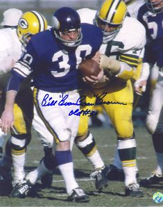 Minnesota Vikings career rushing attempts leader Bill Brown in a football game against the Green Bay Packers at Metropolitan Stadium in Bloomington, MN.