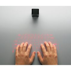 """This functional """"key board"""" is a projection. Currently available in Japan for $352 USD. - COOL!"""