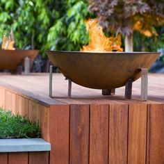 gorgeous outdoor fire 'dish' - would want another boxed in flower bed on the side here though to prevent fire bowl falling on kids below!