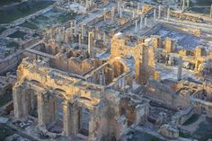 The ruins of Leptis Magna, a prominent city of the Roman Empire, near present-day Khoms, Libya.   copyright by #jasonhawkes  http://www.theatlantic.com/infocus/2013/05/over-libyas-coast/100523/