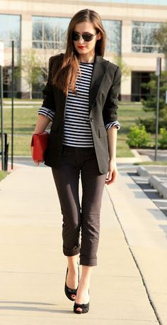black suit, striped t-shirt, red bag, aviators