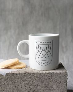 Adventure Awaits - This classic-shaped mug is a surefire conversation starter. A black emblem filled with mountains and evergreens beckons you to get outside. Surefire, Adventure Awaits, Get Outside, Conversation, Mugs, Mountains, Tableware, Classic, Black