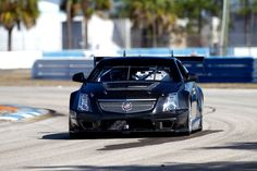 cadillac cts-v coupe with custom wheels racing sport
