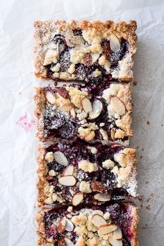 Easy recipe for a gluten free cherry almond tart with a buttery shortbread crust, sweet cherry filling, and almond crumble topping.